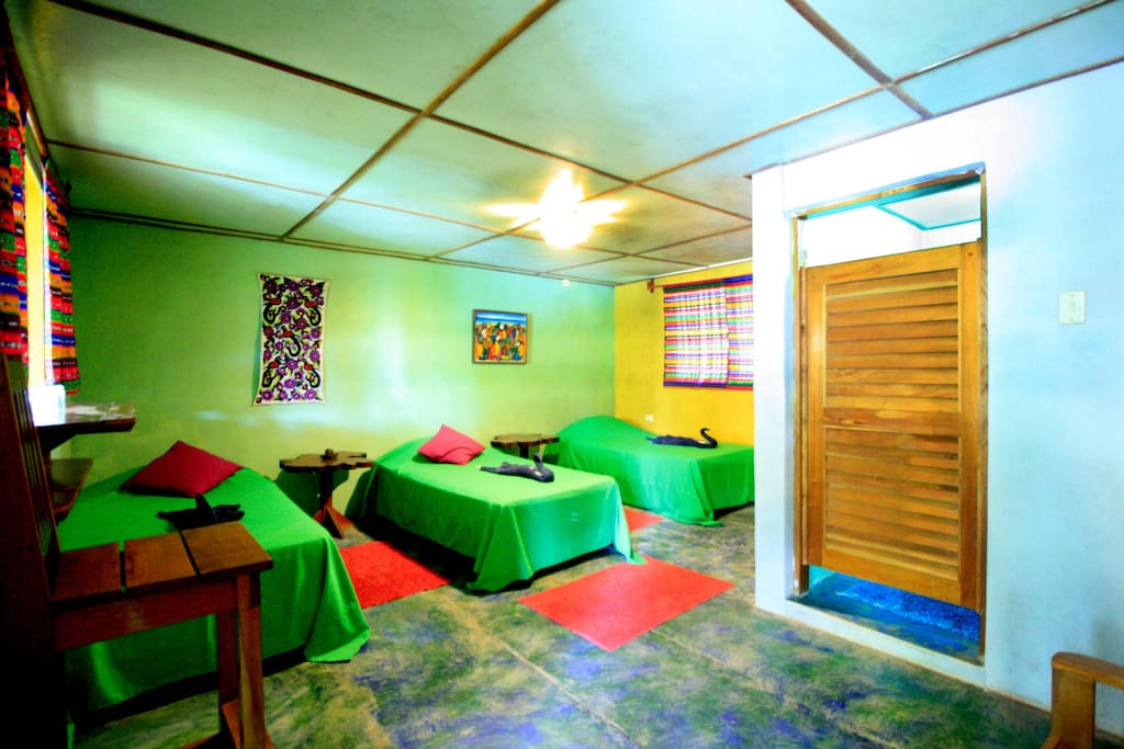 Triple bedroom with three individual beds and private bathroom.