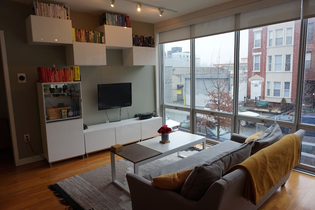 Open living room, floor to ceiling windows