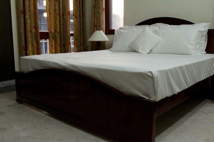 """""""Dream rooms"""" with European styled hardwood bed & side tables and 8"""" imported Spring mattresses are the benchmarks, adding elegance to the  bedroom."""