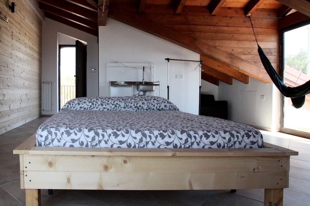 The main bedroom and the sofa bed, located in a little alcova