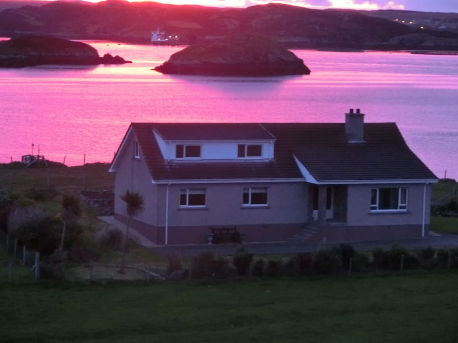 Early summer sunset beside cottage