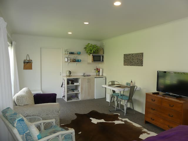 Great space- everything you need, kitchen, armchairs, cafe table, TV.
