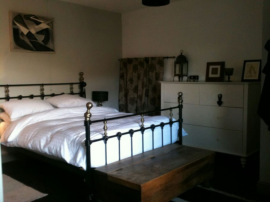 Large bedroom with en-suite located downstairs with view out over garden