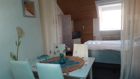 Zimmer mit privaat Badezimmer und Frühstuck