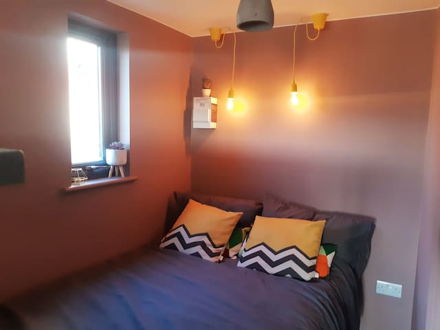 Seperate bedroom with awesome lighting creating perfect space for rest