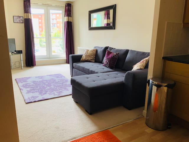 Bright and spacious open plan living room with corner sofa with double sofa bed.