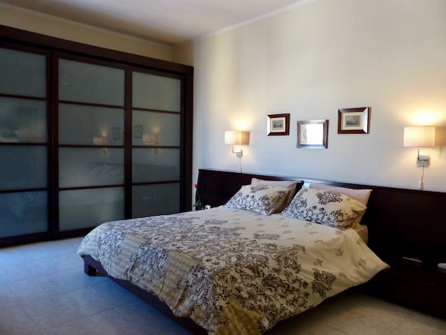 Comfortable large double bedroom with an en-suite bathroom and air condition system.