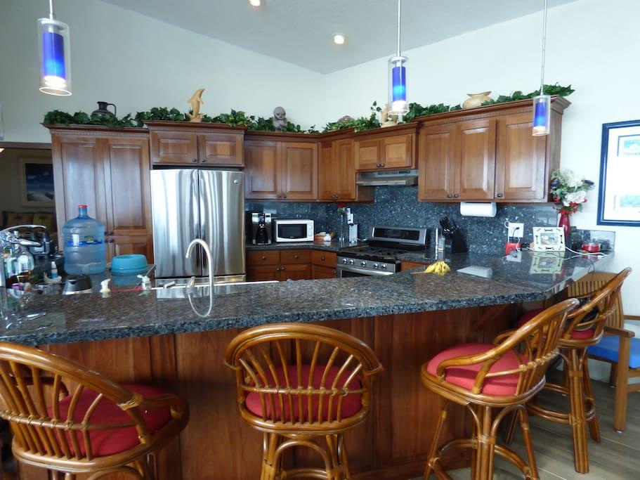 Beautiful Kitchen with Wrap-Around Granite Bar