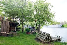 garden, waterside lounge and wood storage.