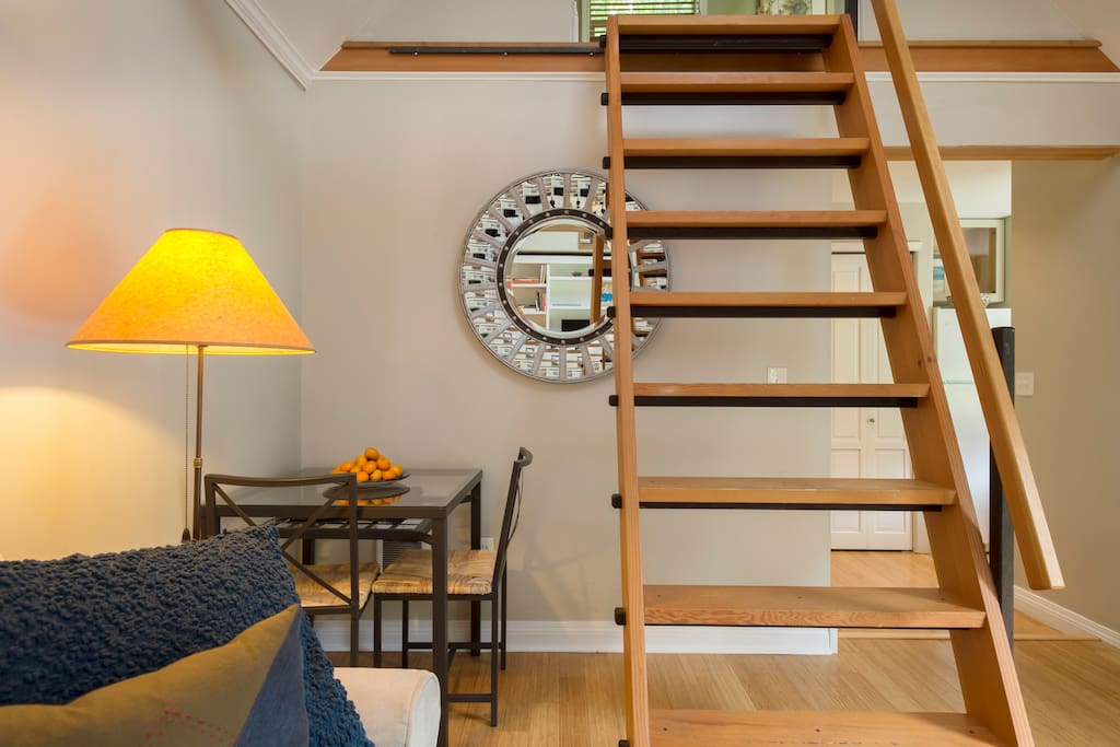 Stair/ ladder with handrail leading to loft