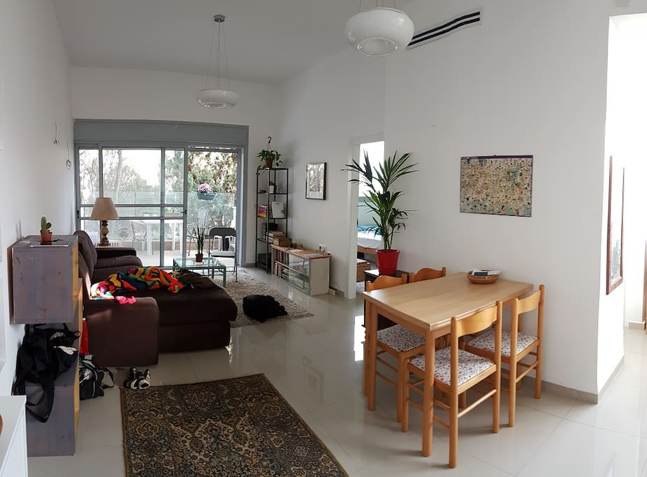 Living room area. Entrance to bedroom is right of the terrace.