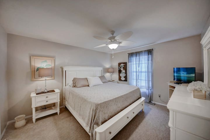 Large master bedroom suite with King bed and walk in large closet with attached private bath