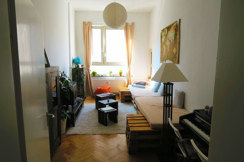 Living room with parquet floor and Piano