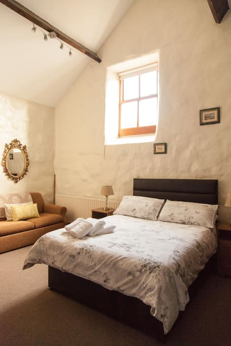 Double room with original stone walls and wooden beams