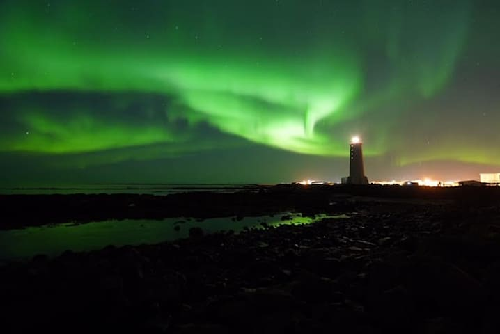 ★ Northern lights in center of lighthouse village
