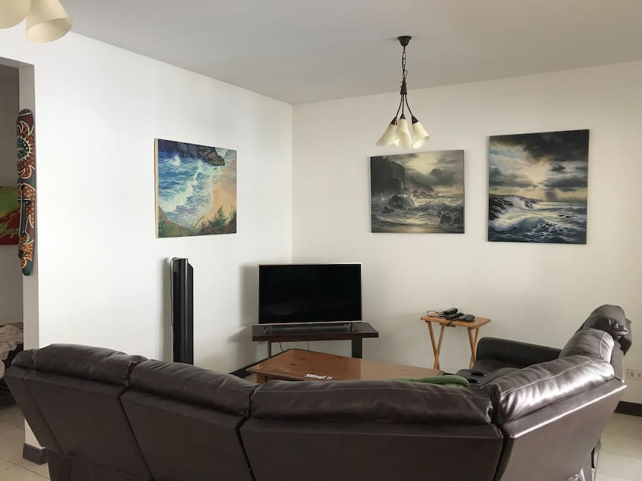 Open and very comfortable living space with flat screen TV and reclinable seating.