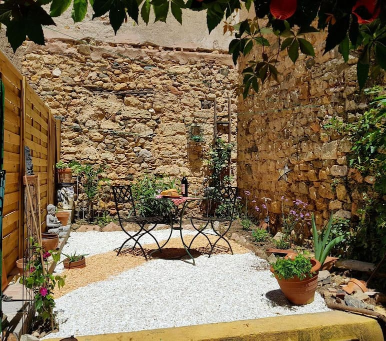 Garden accessed from the courtyard.