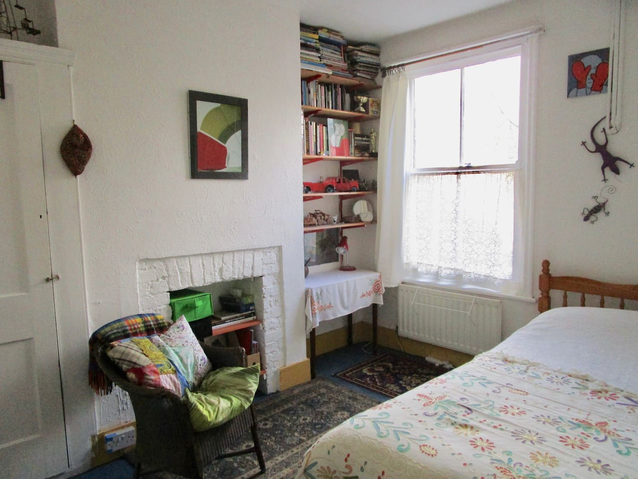 This is a bright, comfortable double bedroom with space to work and relax.