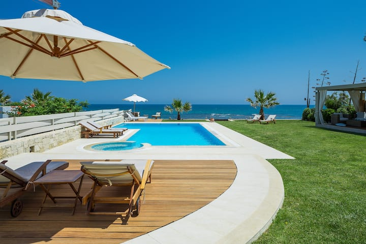 Beachfront Private Villa with a Heated pool