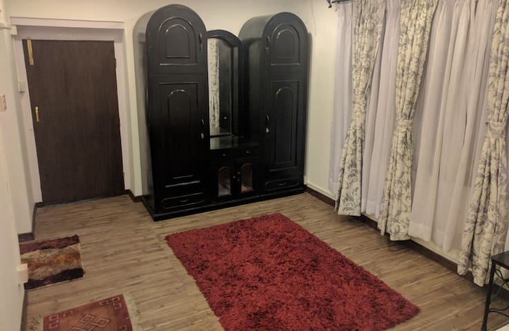 Black wooden cupboard, carpets for extra comfort.