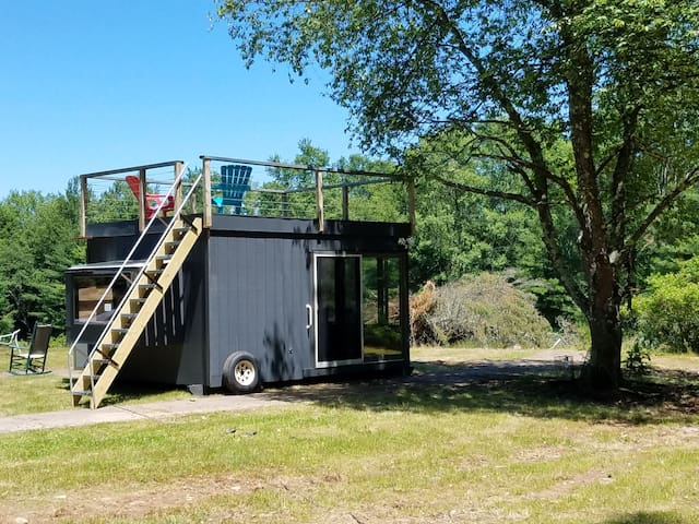 Modern cube combines amenities and nature. Situated in a private meadow bordered by a forest.