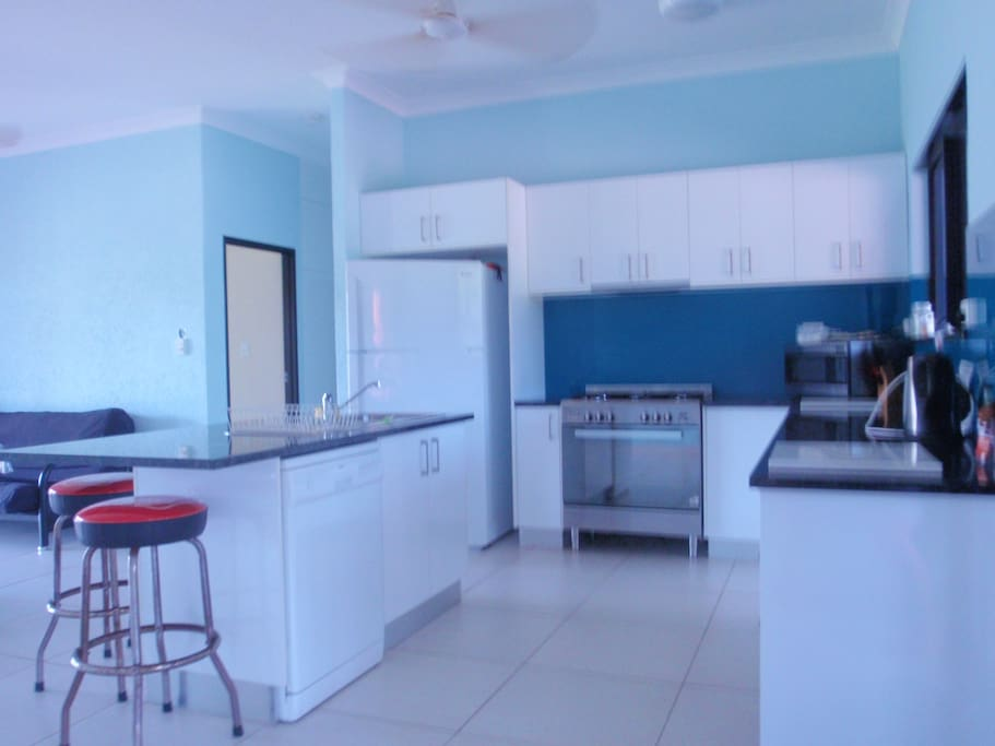 Kitchen with gas stove, dish washer, microwave, kettle and toaster