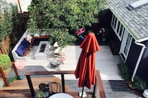 View from our house - Studio Shared garden, bikes, fire BBQ - just a great sunny please to read a book.