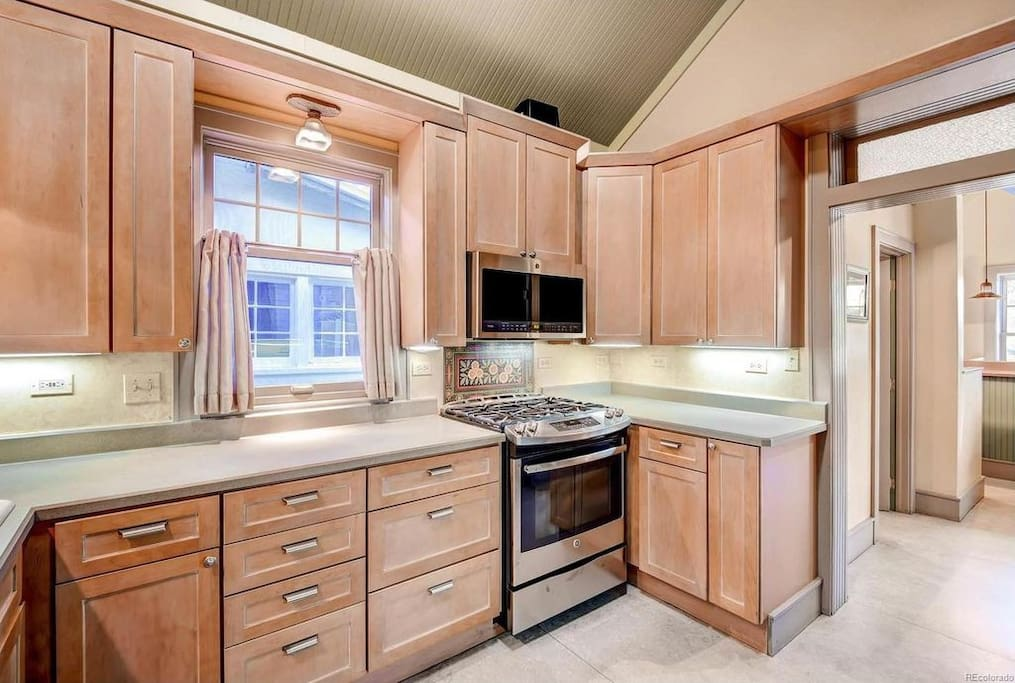 Large open kitchen with brand new GE profile stainless appliances.