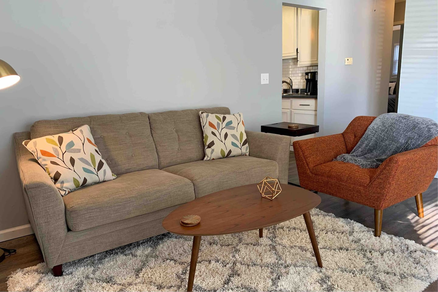 Plenty of room in the stylish living area. Including a full-size couch, mid century modern chair, desk and office chair, smart TV, retro lamp, and board games!