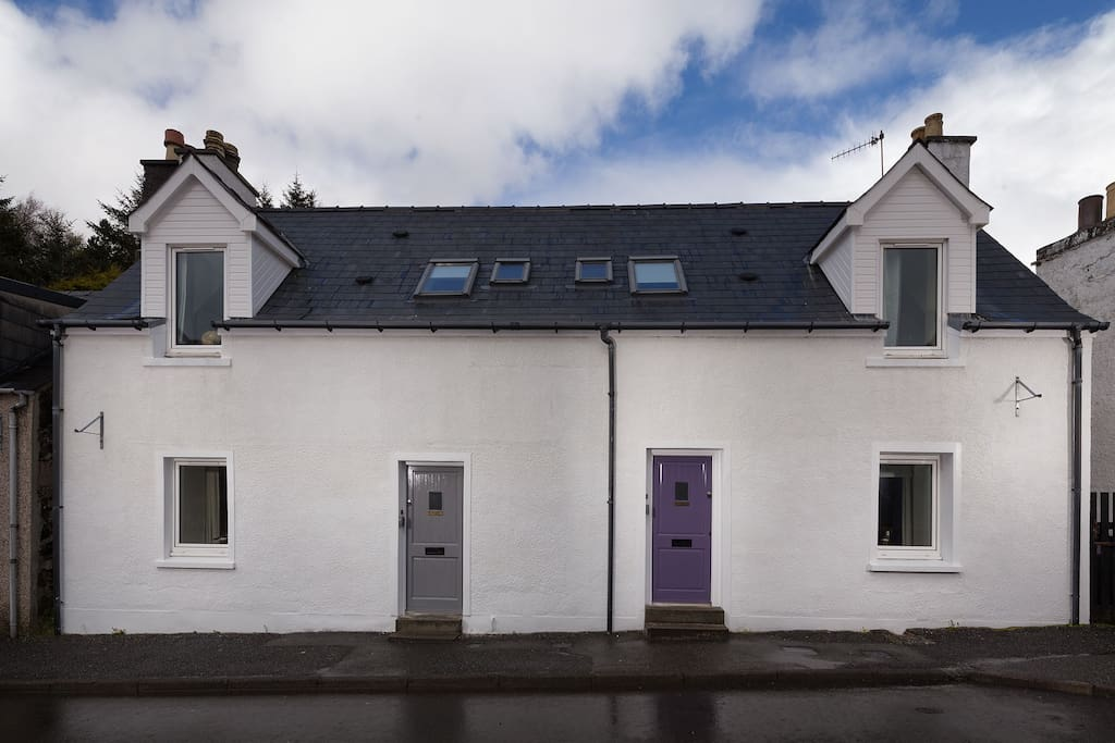 Cleiseabhal cottage with the purple door. Sunshine and Showers.