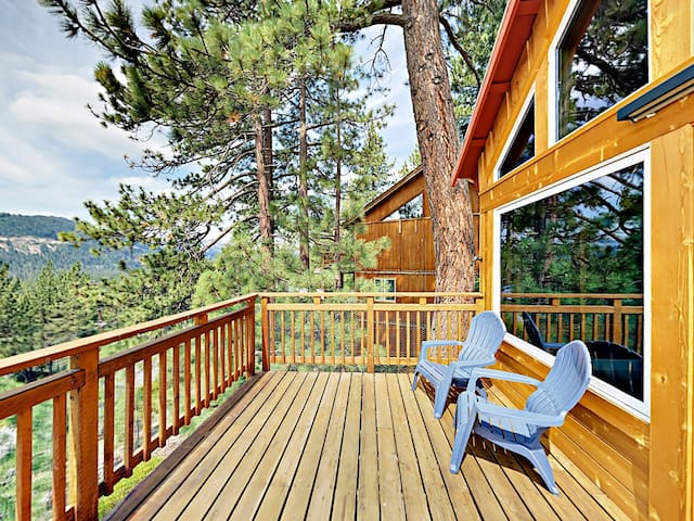 Back deck with 2 Adirondack chairs and gorgeous panoramic mountain views.