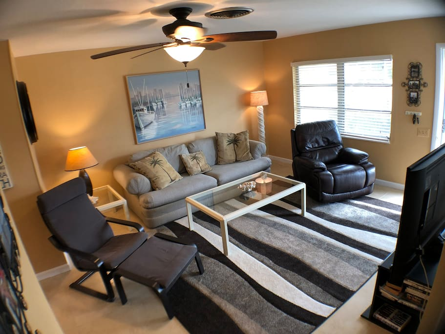 The couch in the center is a sleeper-sofa and pulls out to a bed if needed!