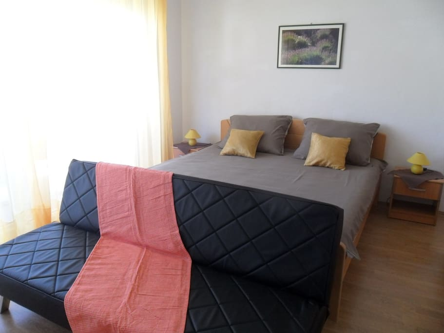 The bedroom with the balcony and partial seeview.