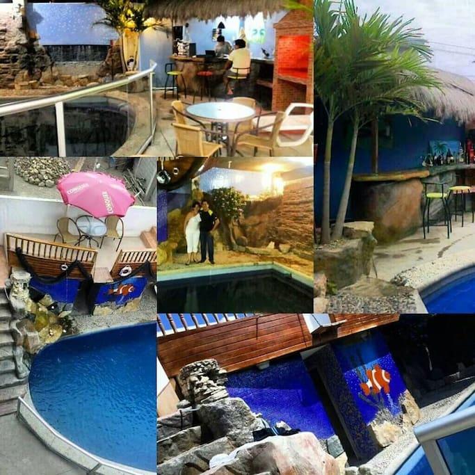 Area social decorada a forma de arrecife marino cuenta con barbacoa, piscina, pergola, mesas, sillas plegables, hamaca