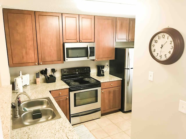 Full kitchen with oven, microwave, dishwasher, refrigerator, pots/pans, cooking utensils, and silverware.