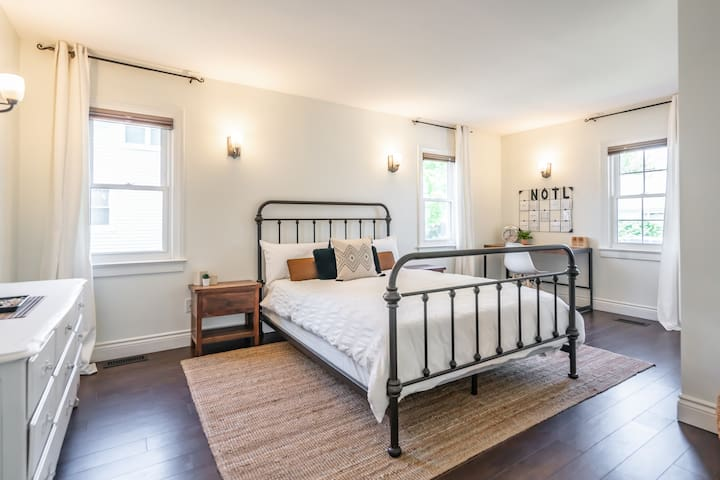 Very spacious master bedroom with queen size bed, with Canadian made Juno mattress, hotel quality linens, king size pillows, double closets, work desk, full size mirror and black out blinds.