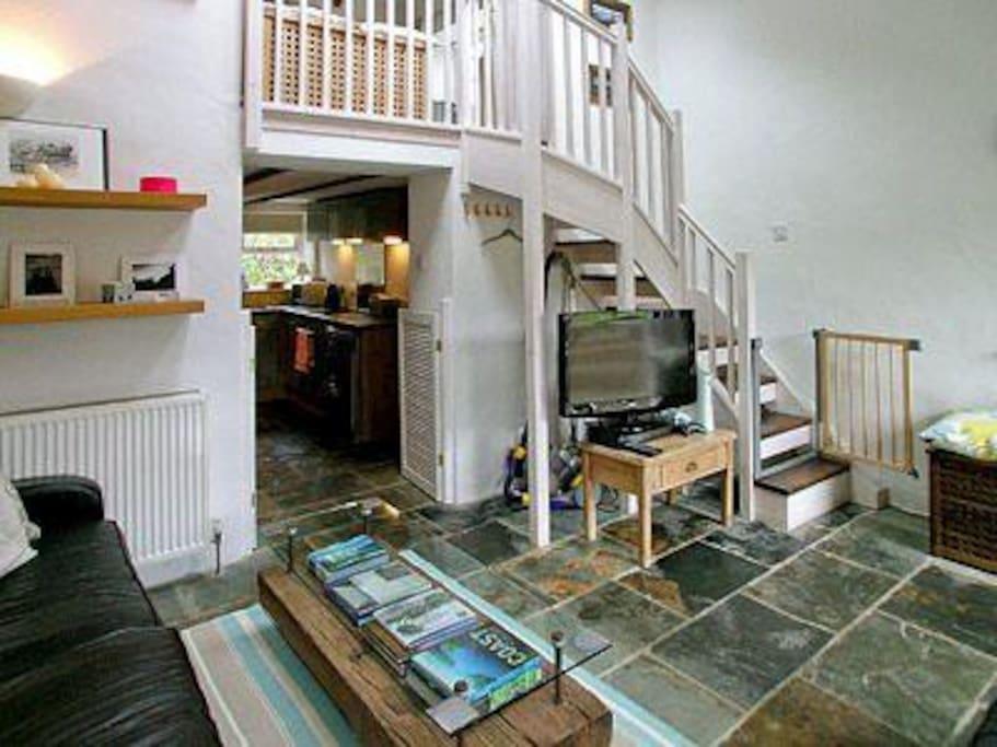 Barn - Lounge, stairs to mezzanine bedroom