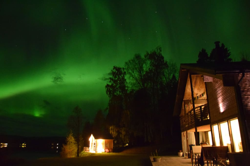 Northern Lights over the house and cabin.