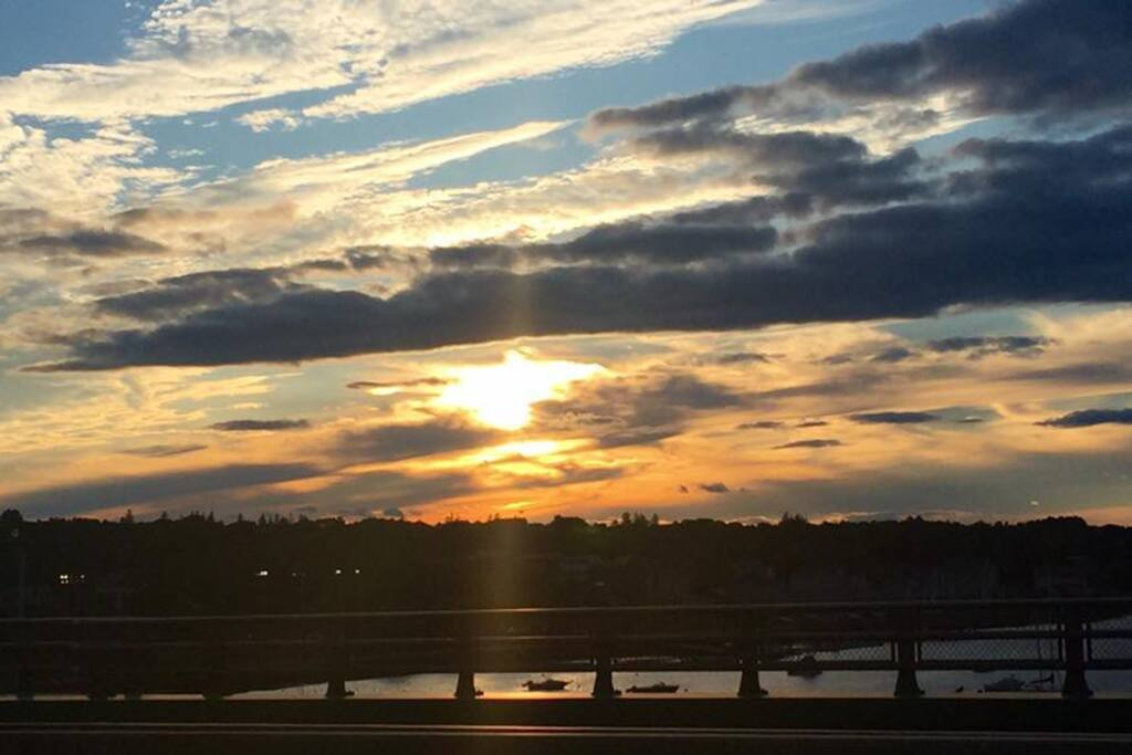 Sunset over the Merrimac river bridge nearby