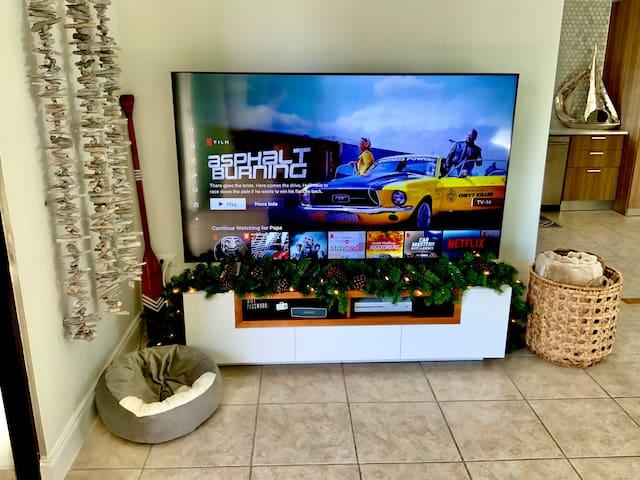 "75"" smart TV with Netflix, Hulu, Disney+, Xbox One console."