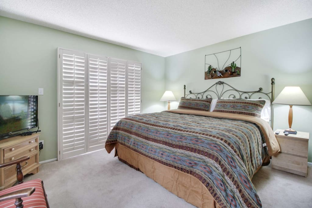 Master bedroom features King size bed, TV, private bathroom and arcadia doors that open up to the back patio