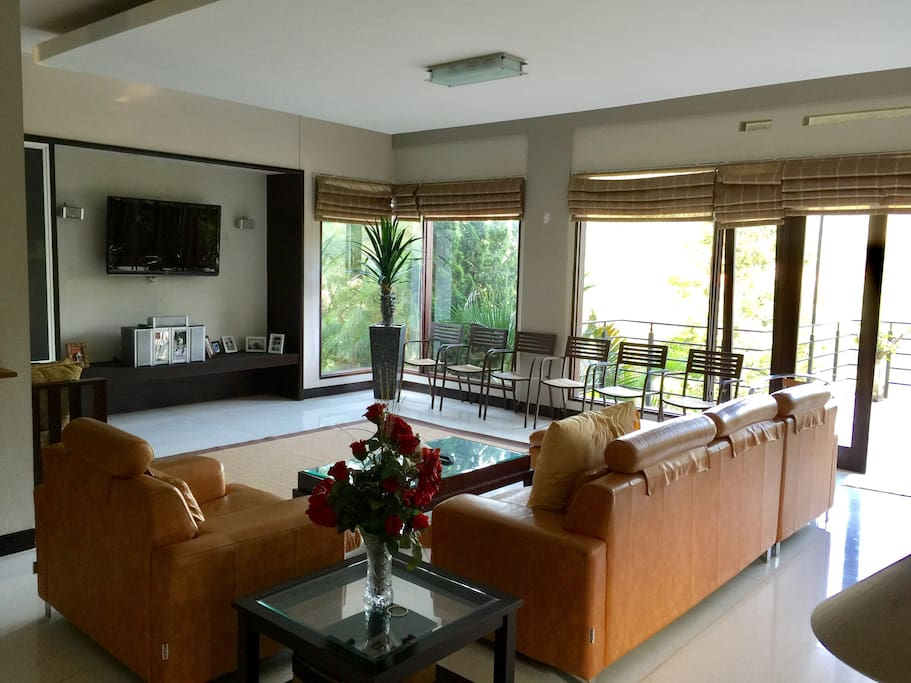 Level 1 - living room with glassed-window overlooking the valley view
