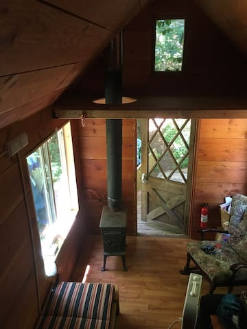 Tiny house w/ loft 4 sleeping on shared property.