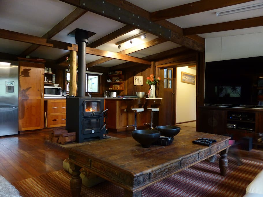 Kitchen and Living areas open plan, large TV