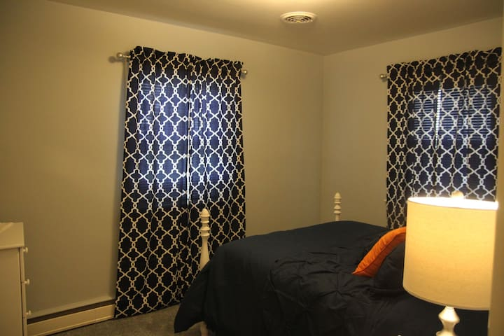 3rd bedroom with full bed, dresser, and closet