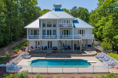 Private pool on the lake with 2 level boathouse