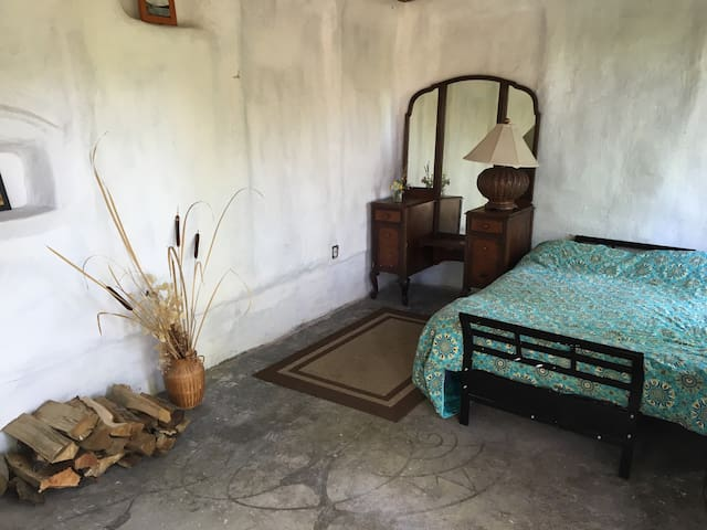 Your bed and dresser and some firewood in the cottage.