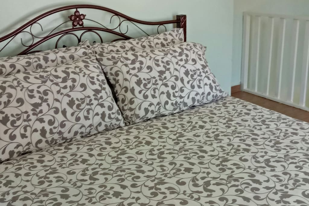 The queen size bed upstairs.