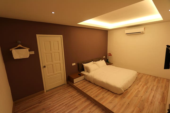 Room 1 king size bed with attached bathroom. White towel sheet with enhanced simplicity, they are classic feel assured.