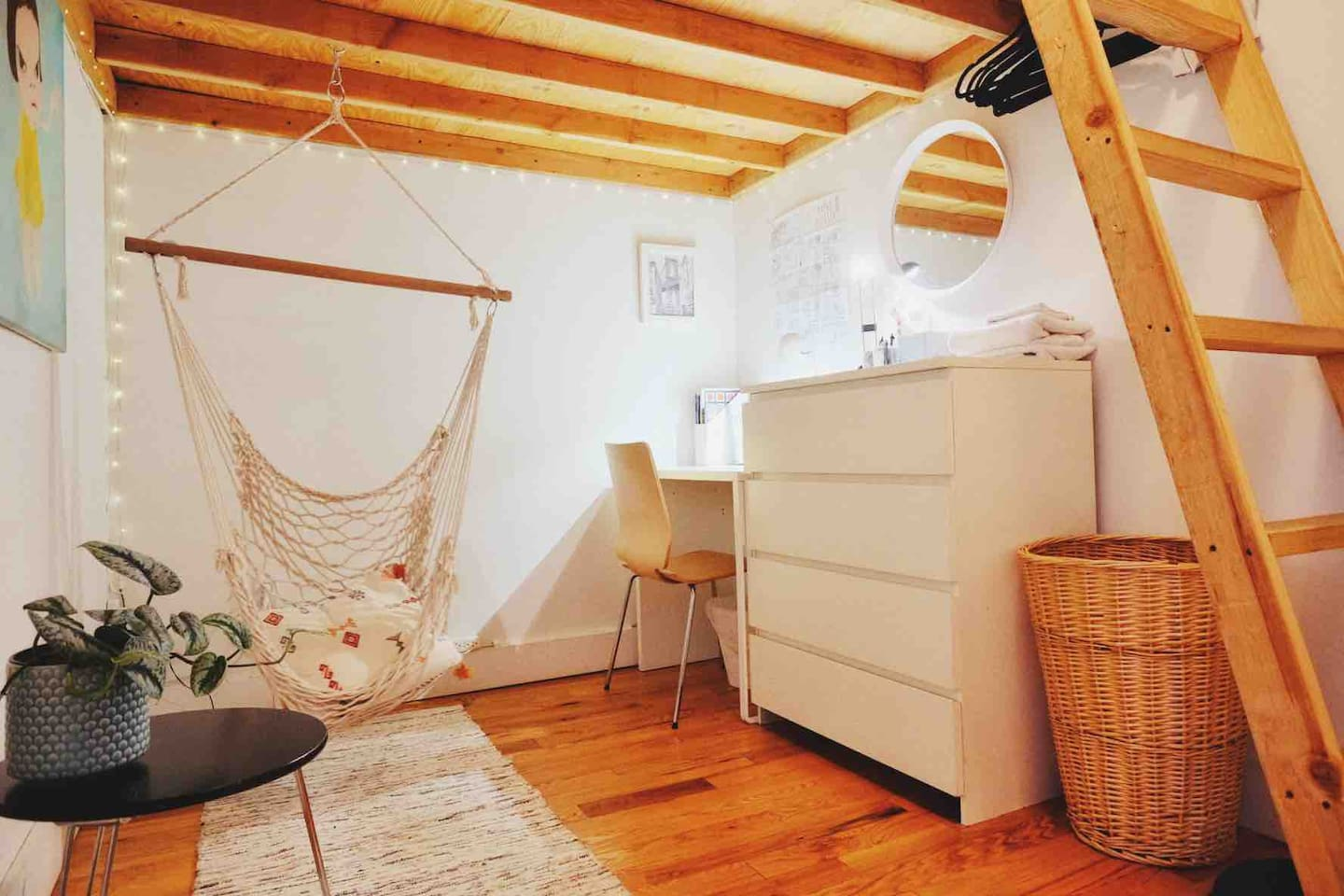 Lower part of the bedroom with a hammock, desk, and dresser